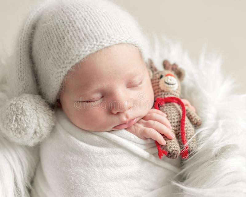 Cute sleeping baby with toy stock photo