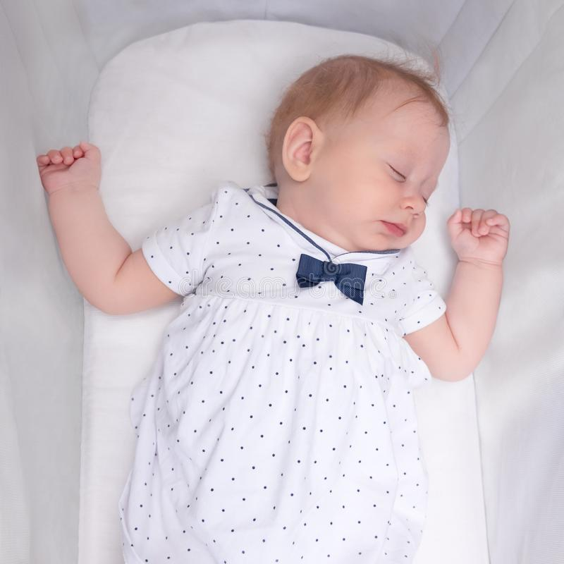 Cute sleeping girl. Baby sleep concept. Newborn baby in her crib. stock image