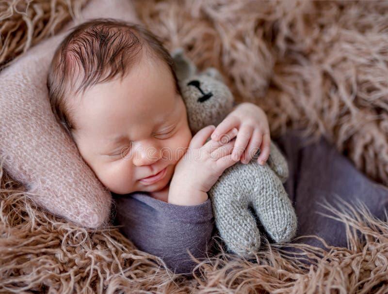 Sleeping newborn baby boy royalty free stock image