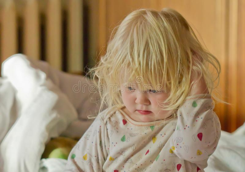 Cute sleepy girl in bed in the early morning stock photo