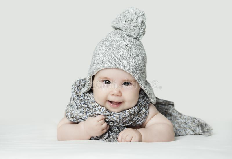 Cute small baby in knitted hat, portrait. Happy child stock photos