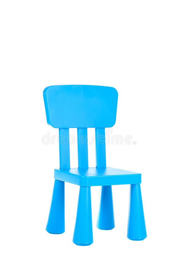 Cute small blue plastic chair for kids isolated on white background. Cute small blue plastic chair for children isolated on white background royalty free stock images