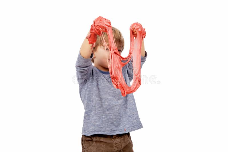 Cute small boy playing with slime royalty free stock photo