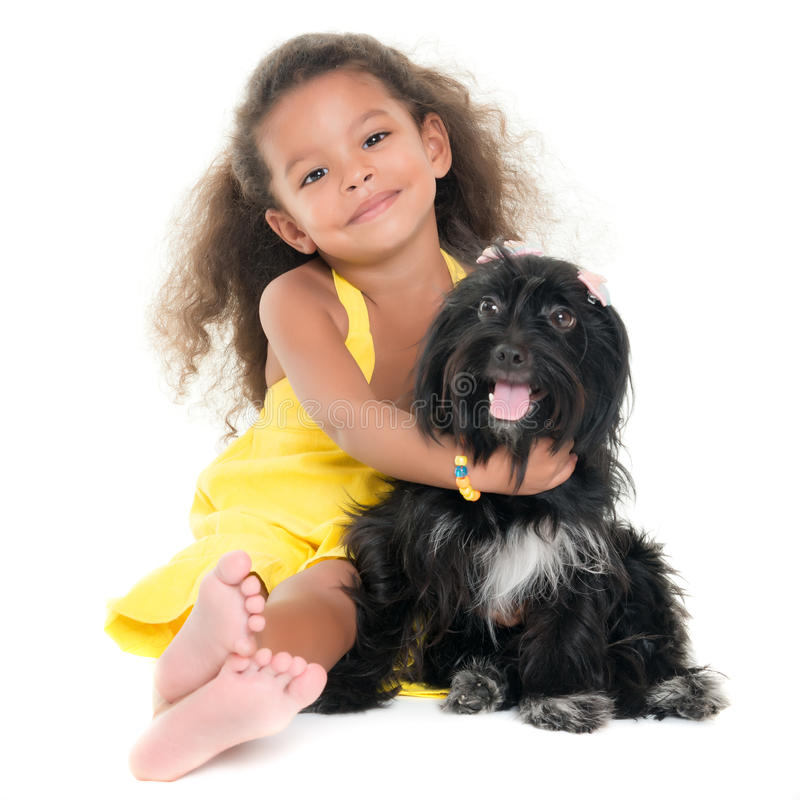 Cute small girl hugging her pet dog royalty free stock images