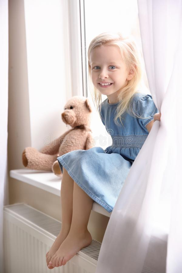 Cute small girl sitting stock photography