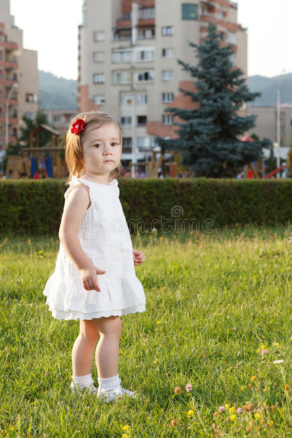 Download Cute Small Girl Standing In Grass Stock Photo - Image: 25938594