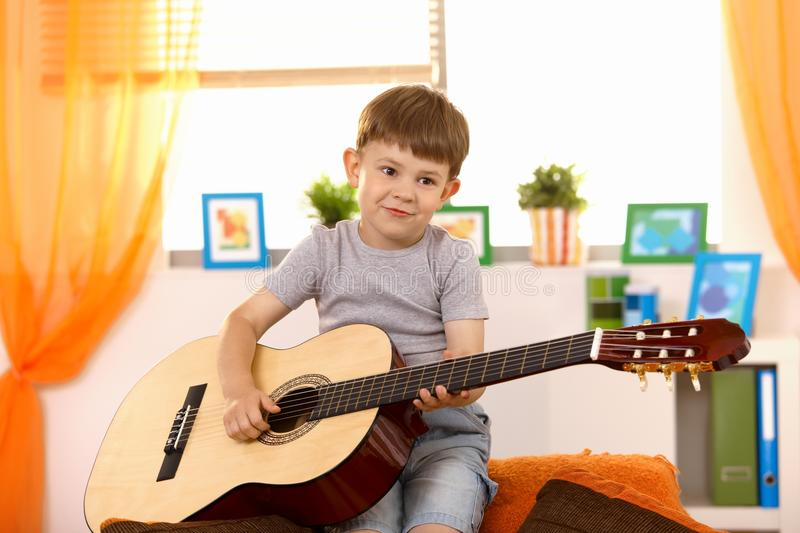 Download Cute small kid with guitar stock photo. Image of good - 18493374