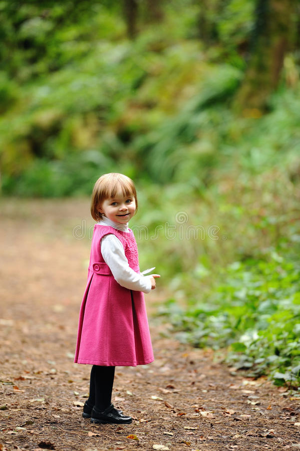 Cute Smile. A cute little girl in pink stock images