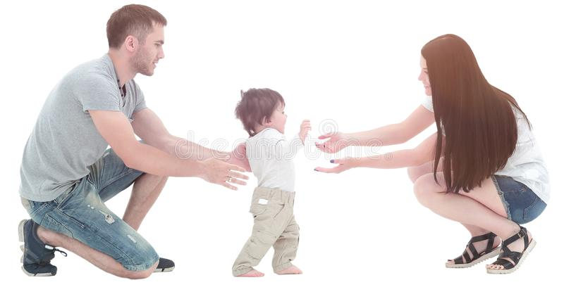 Cute smiling baby boy learning to walk stock photo