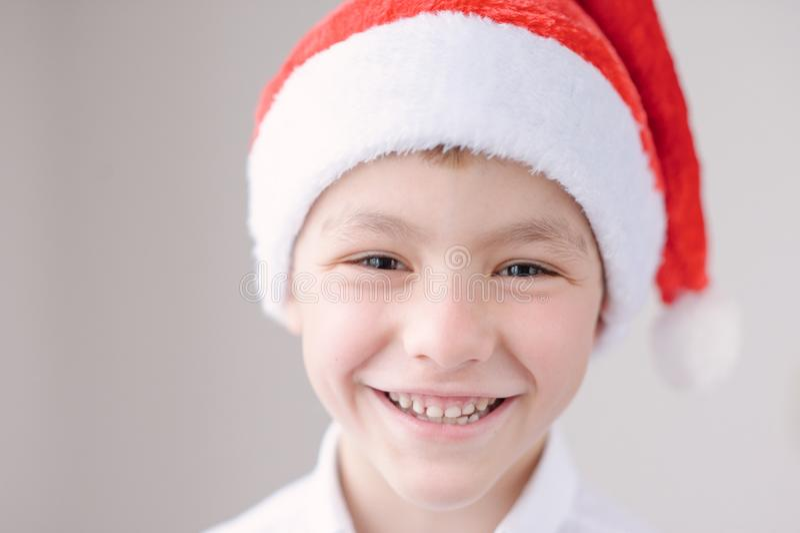 Cute smiling boy in Santa hat stock image