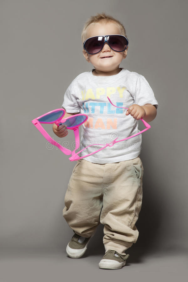 Cute smiling child boy in sunglasses stock photos