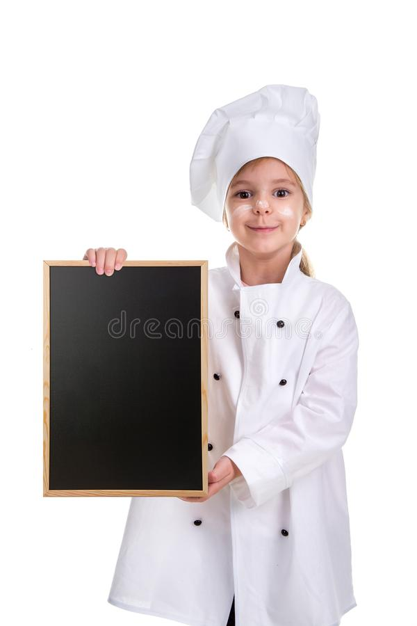 Cute smiling girl chef white uniform isolated on white background. Girl with a floured face holding a menu black empty stock photography