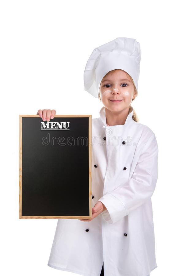 Cute smiling girl chef white uniform isolated on white background. Girl with a floured face holding a menu black empty royalty free stock image