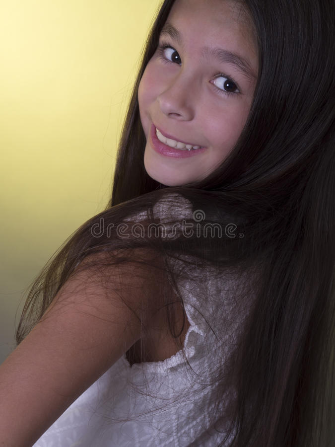 Cute, smiling girl with long hair royalty free stock image