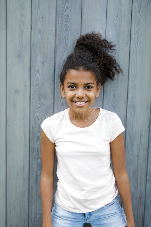 Cute smiling girl looking at camera stock photo