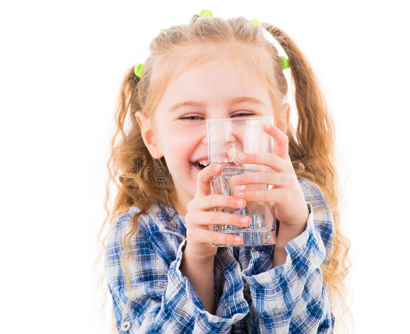 Little baby girl holding a glass of pure water stock images