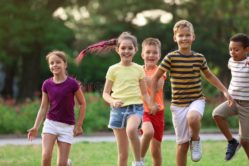 Cute smiling little children playing royalty free stock image