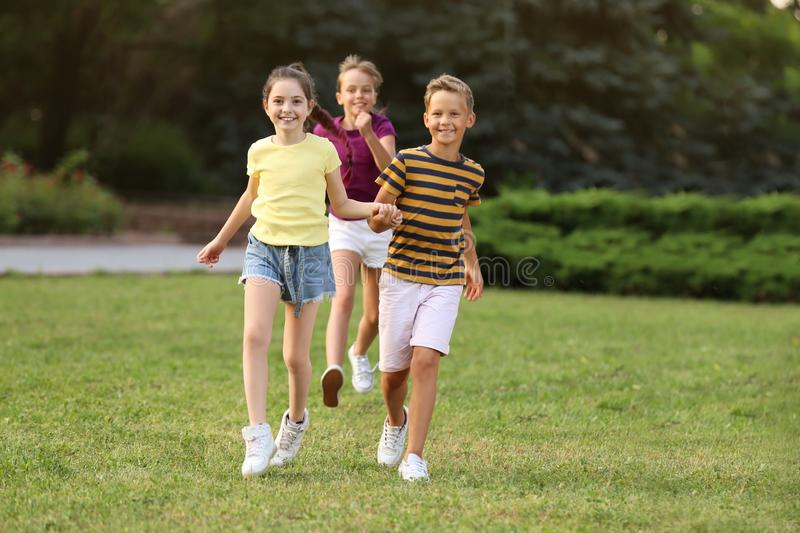 Cute smiling little children playing stock image