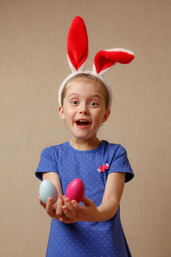 Cute smiling little girl with colorful easter eggs. Happy easter. selective focus stock photo