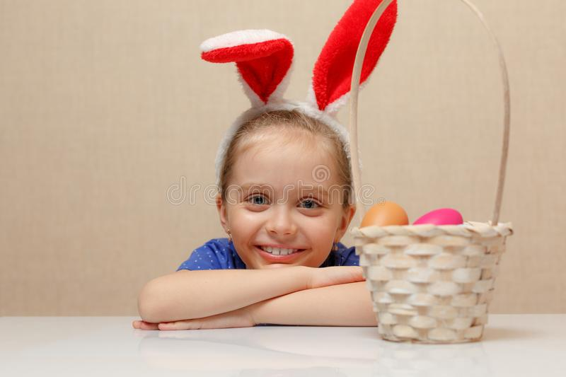 Little girl with basket Easter eggs stock photos