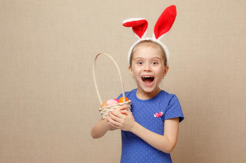 Little girl with basket Easter eggs stock photography