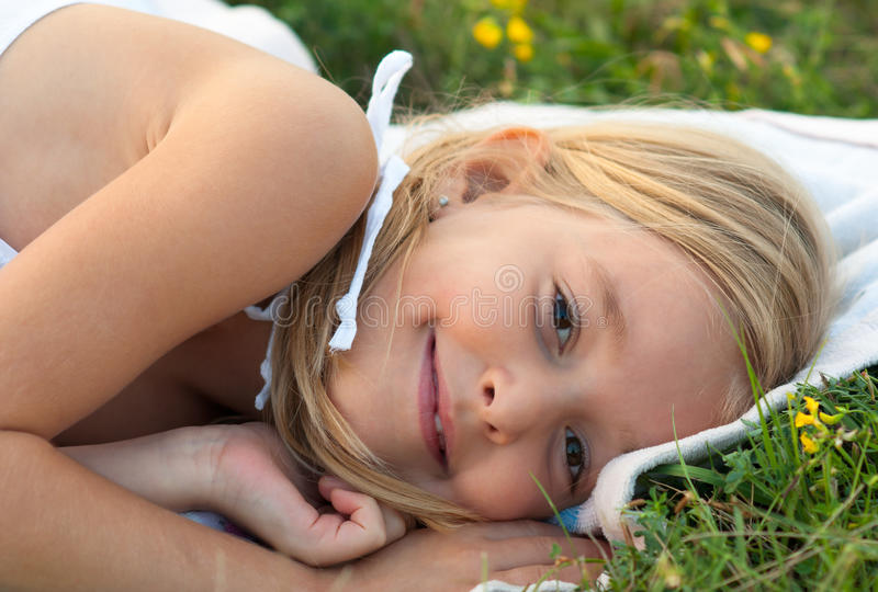 Download Cute Smiling Little Girl Lying On The Blanket Stock Photo - Image: 26162198