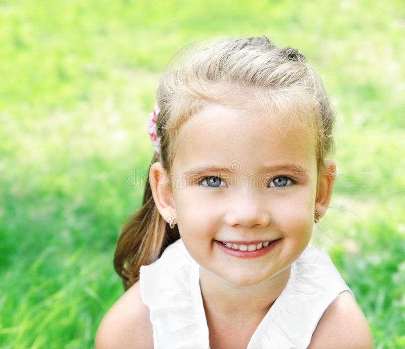 Download Cute Smiling Little Girl On The Meadow Stock Image - Image: 33208361