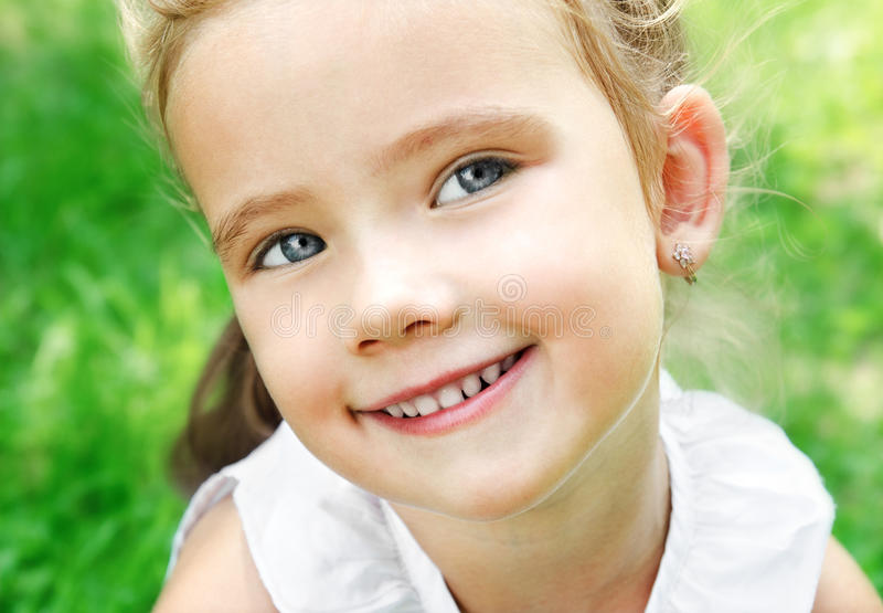 Download Cute Smiling Little Girl On The Meadow Stock Image - Image: 33208365