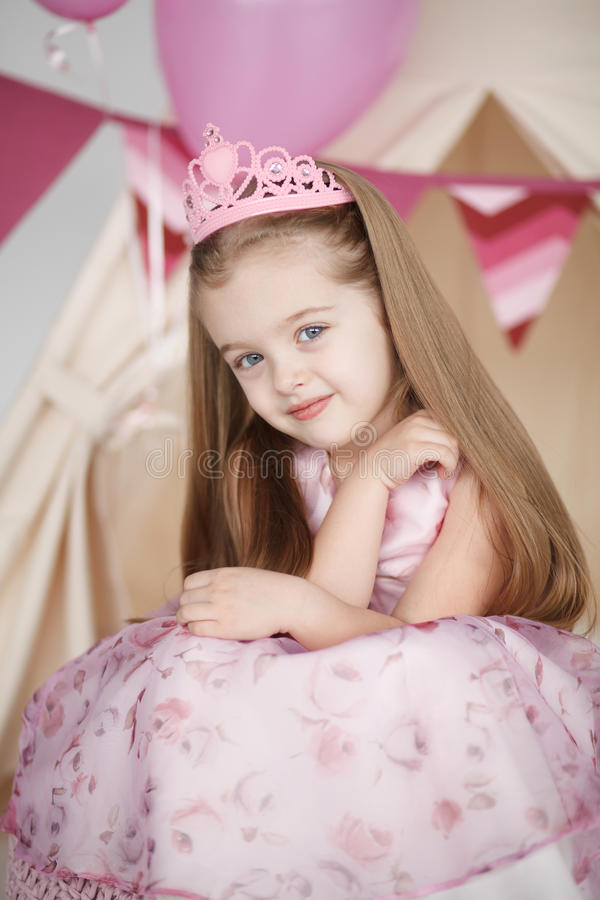 Cute smiling little girl in pink princess stock images