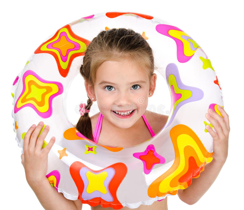 Cute smiling little girl with rubber ring. Isolated on a white royalty free stock images