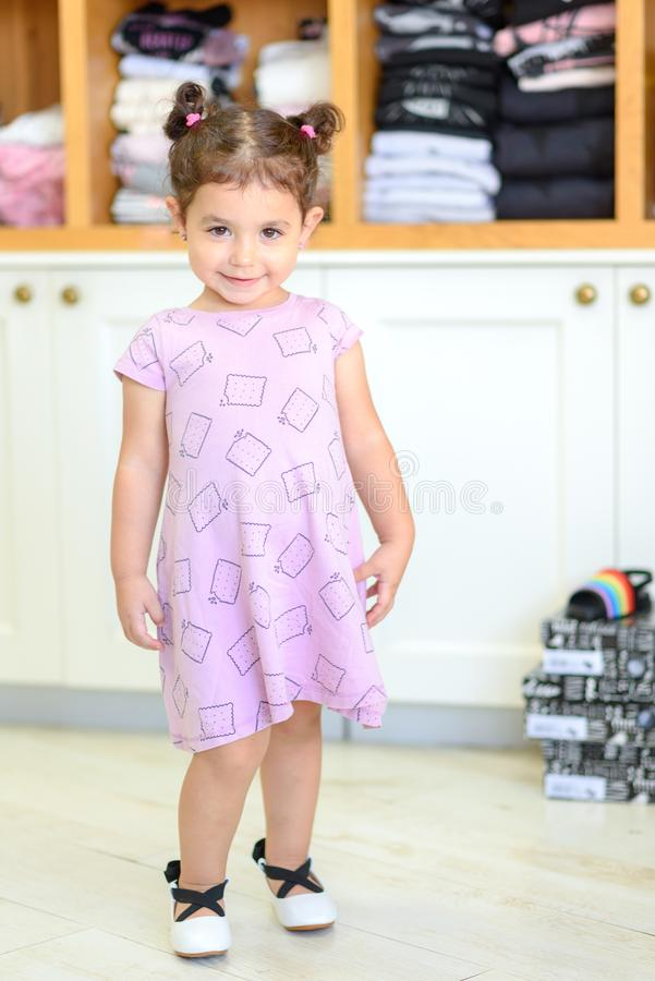 Cute smiling little girl shopping in store. stock photos