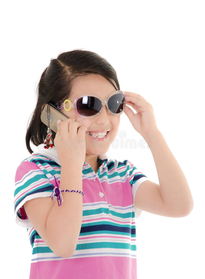 Cute smiling little hispanic girl in sunglasses. Over white. This image has attached release royalty free stock photos