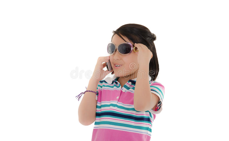 Cute smiling little hispanic girl in sunglasses. Over white. This image has attached release royalty free stock images