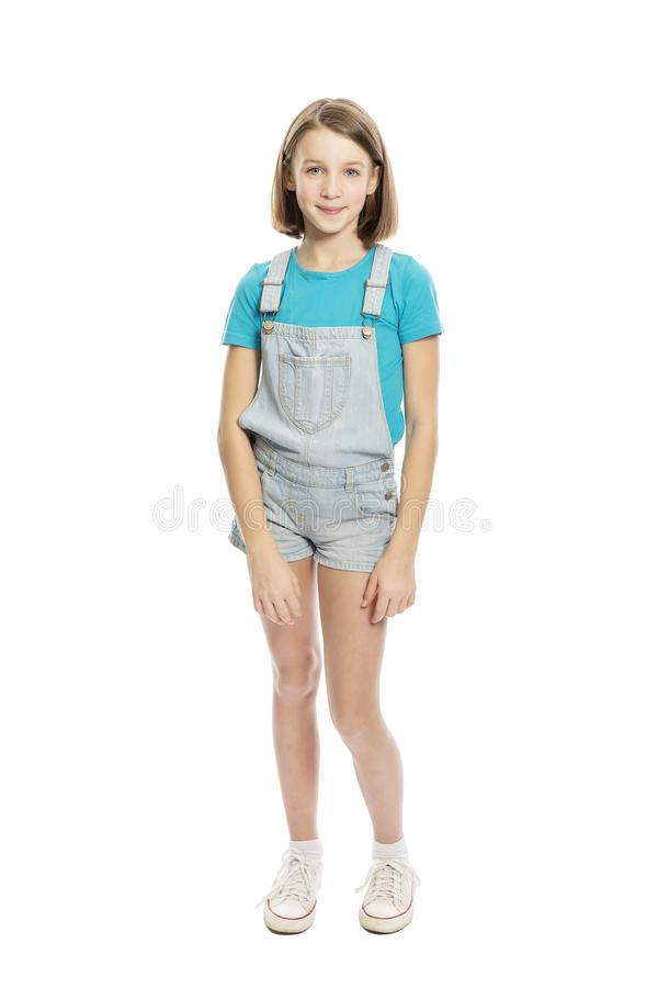 Cute smiling teen girl in full growthl. Isolated on a white background royalty free stock image