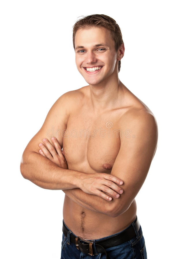 Cute smiling young guy in jeans with bare torso stock photos