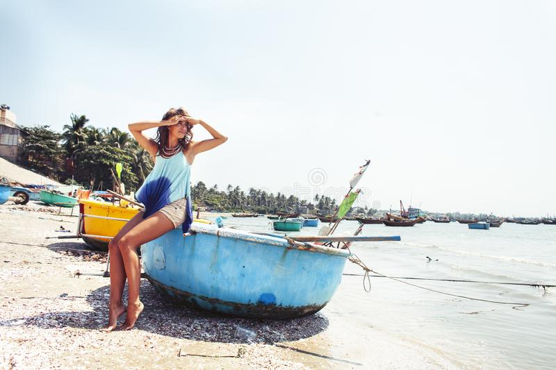 Cute smiling young real woman in asian country sea port, vietnam traveller lifestyle. Cute smiling young real caucasian woman in asian country sea port, vietnam royalty free stock images