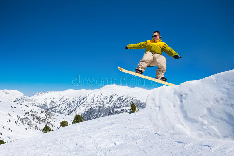 Cute snowboard man jumping royalty free stock photo