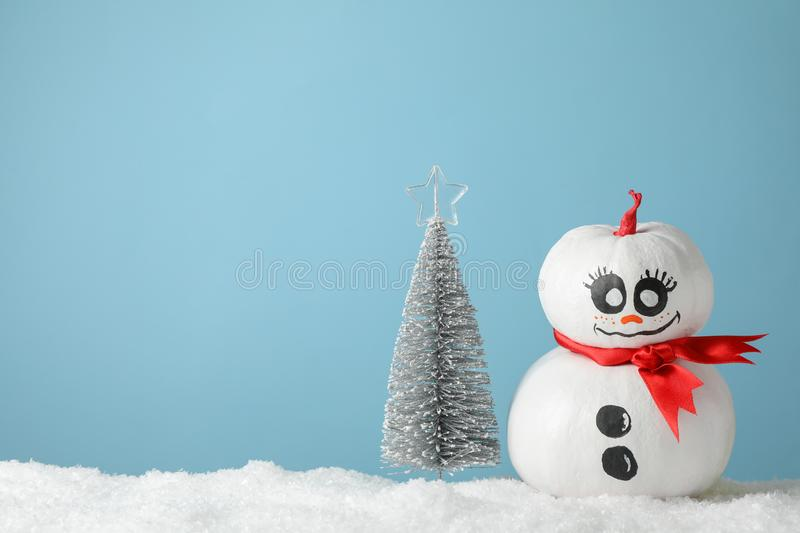 Cute snowman and Christmas tree on blue background. Space for text stock photos