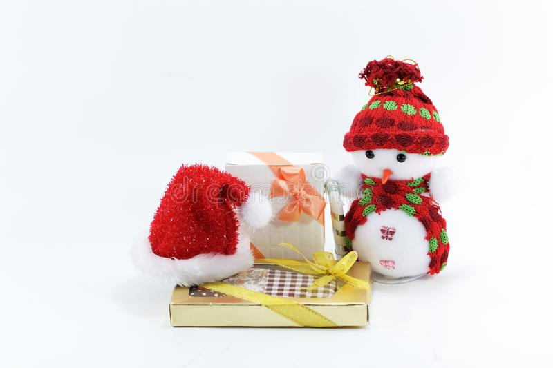 Cute Snowman doll on white background with red hat and gift, toy for christmas stock photography