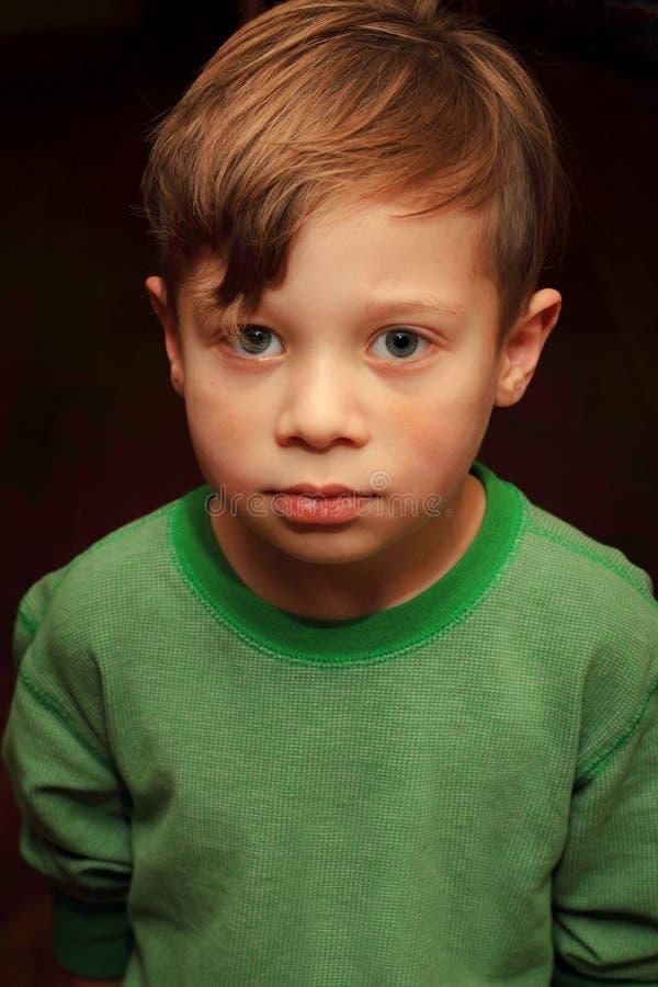 Cute Somber Sober Young Boy stock photo