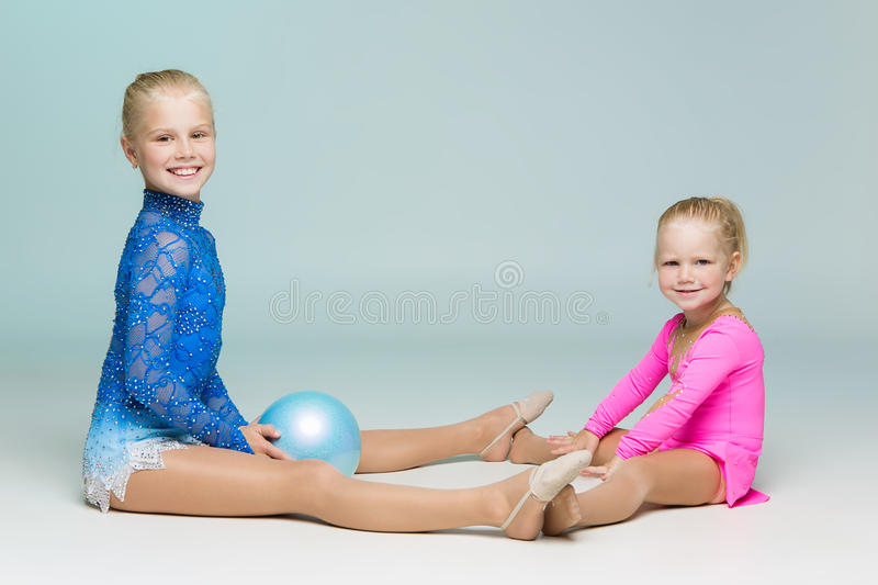 Cute sporty sisters posing looking at camera royalty free stock images