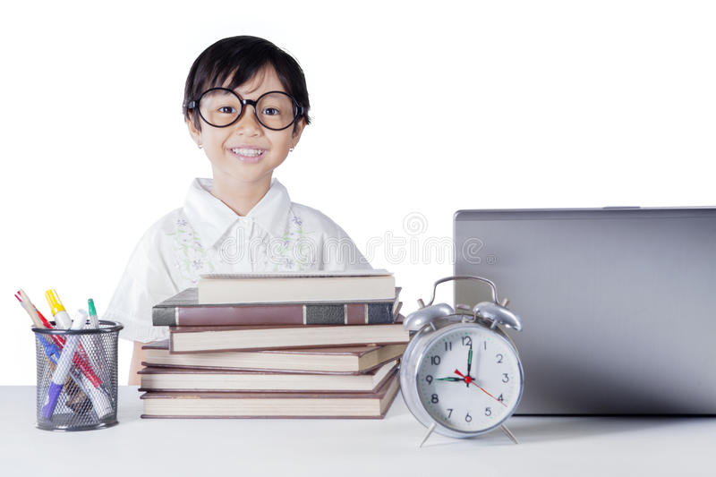 Cute student with books and laptop stock photography