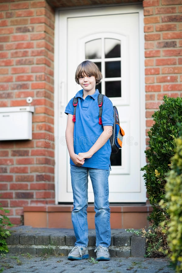 Cute student boy on his way to first day at school stock image