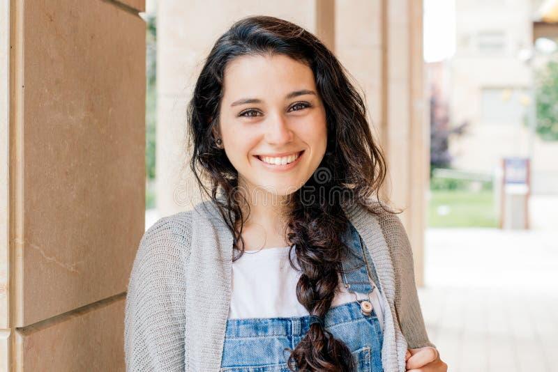 Cute student girl looking at camera royalty free stock photography
