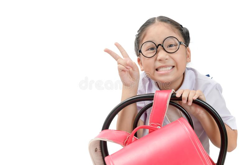 Cute student smile and sit on the chair royalty free stock image
