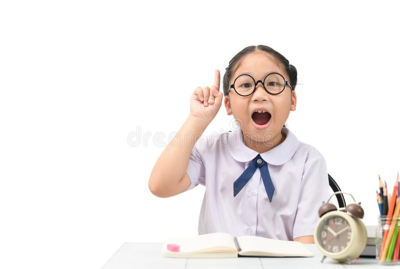 Cute student thinking while doing her homework stock images