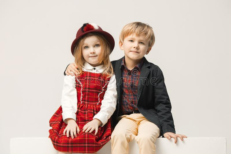 Cute stylish children on white studio background stock photography