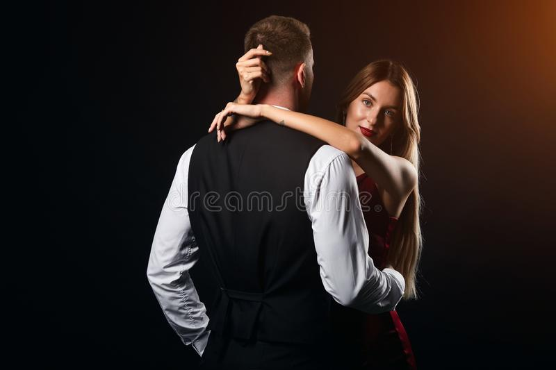 Cute stylish couple dancing together at the nightclub royalty free stock photography