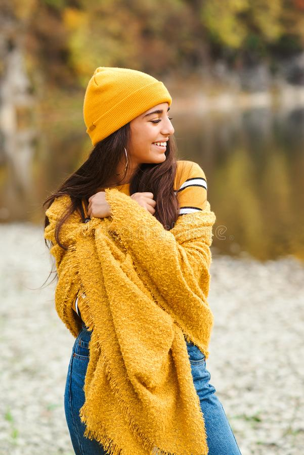 Cute stylish girl in good mood posing in autumn day. Woman enjoying autumn weather. Beauty and fashion royalty free stock photos