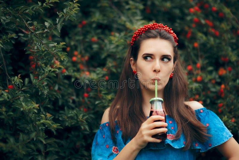 Cute Summer Girl Drinking Cherry Fruit Juice Outdoors stock photo